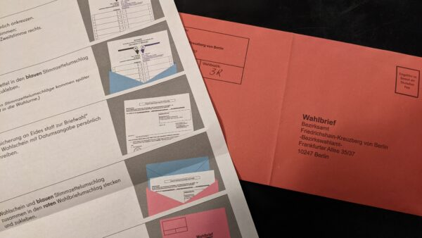 My postal vote in the iconic red envelope and part of the instructions